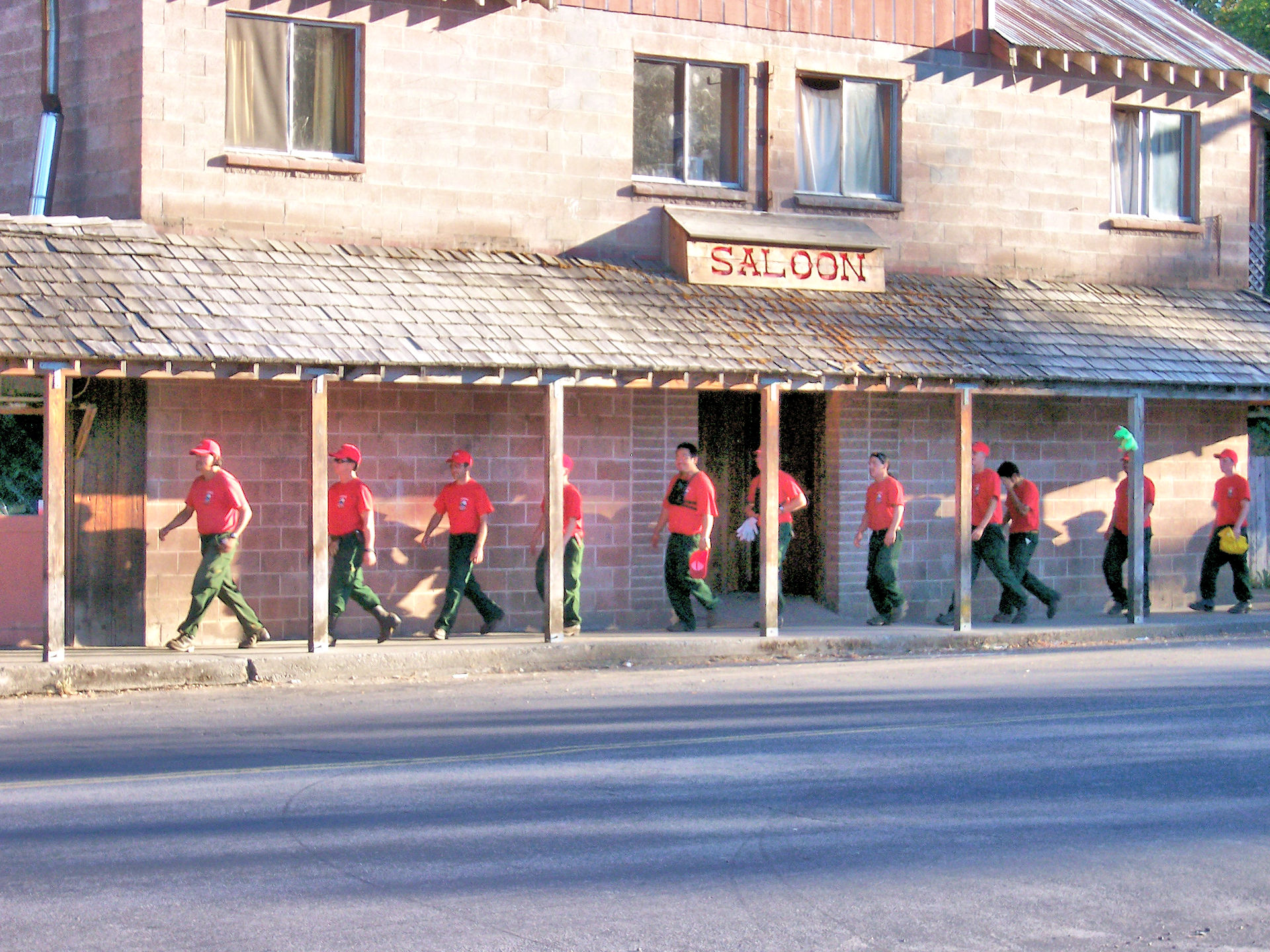Firefighters walking in front of the saloon.