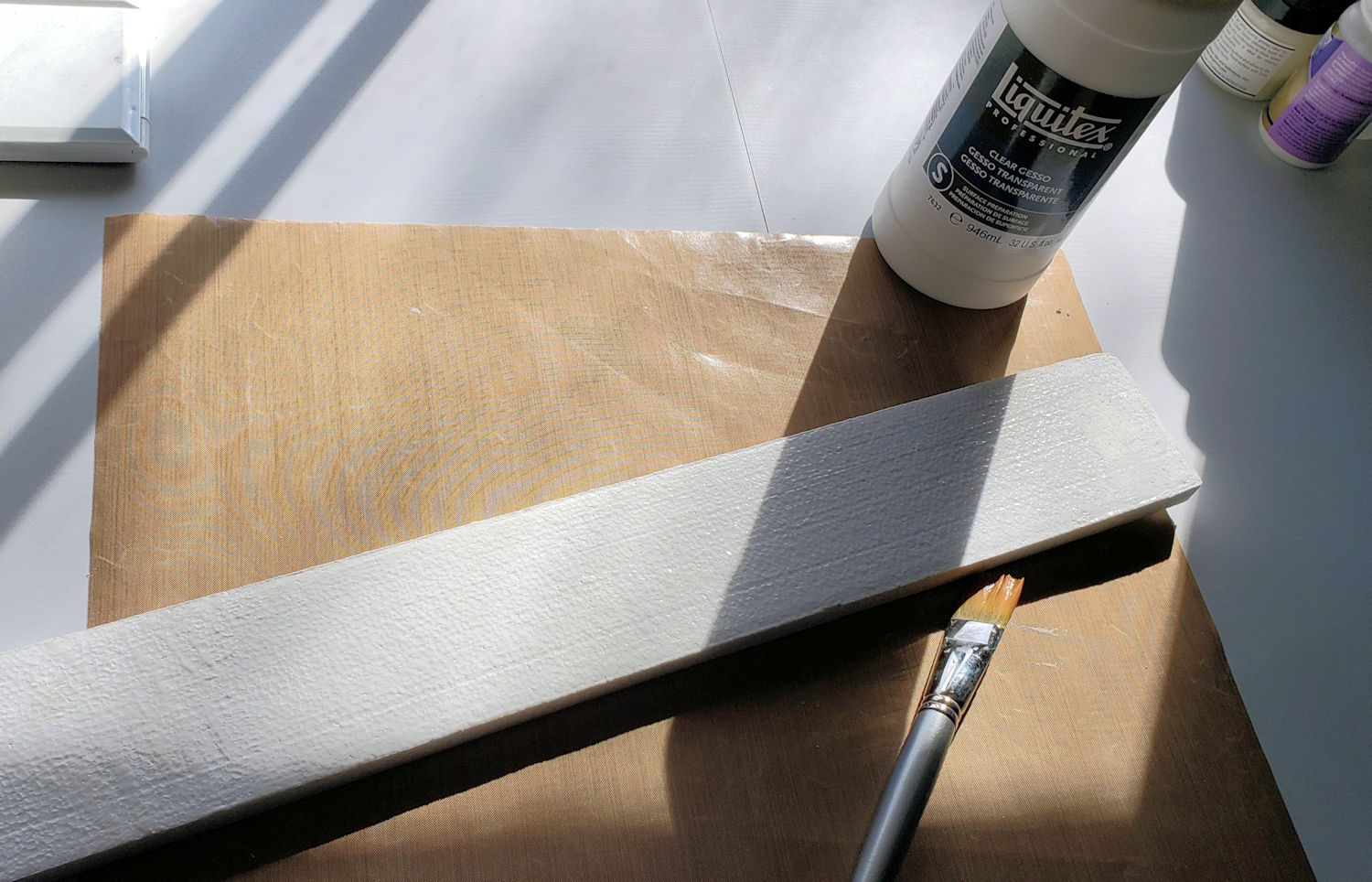 Applying gesso to styrofoam.