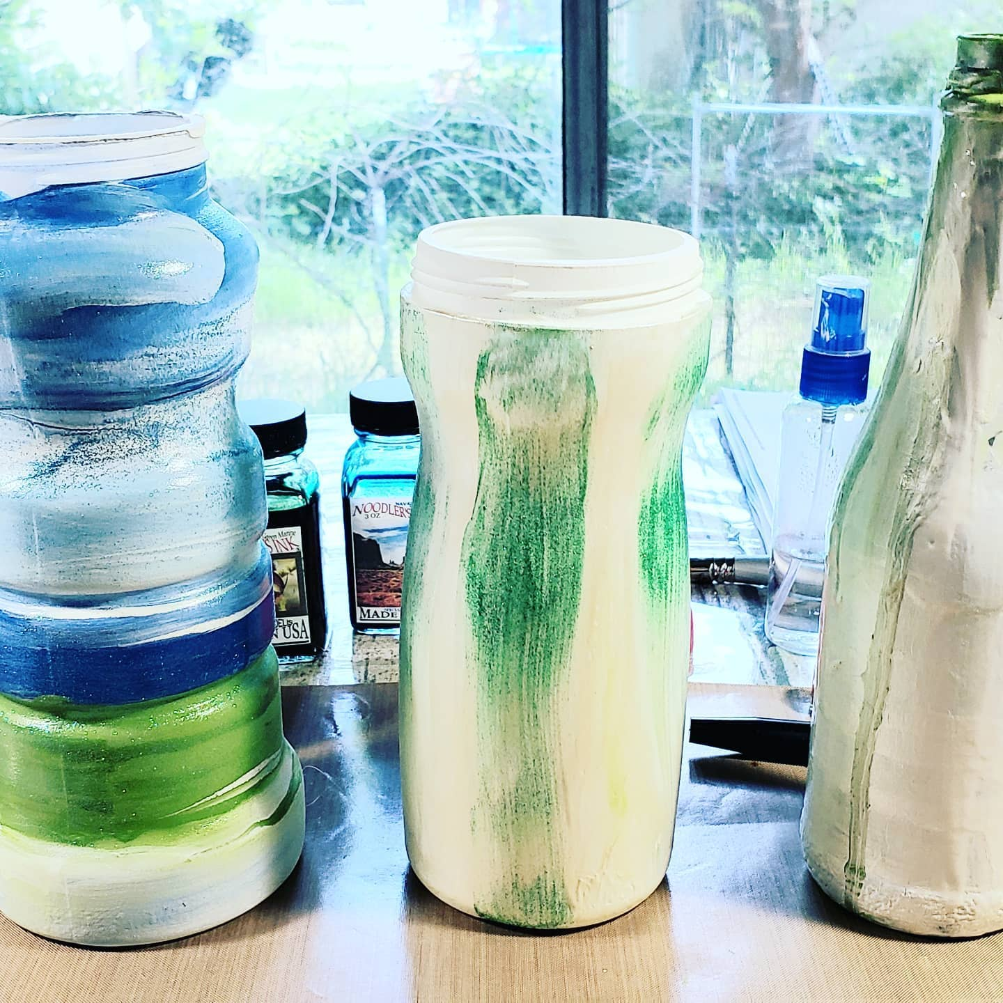Painted food containers - for vases. #upcycle Used gesso, acrylic paint, glitter paint, pearl finish Ceramcoat. http://lindajomartin.com